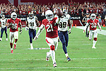 Arizona Cardinals defensive back Patrick Peterson makes an interception and returns it for a touchdown during a regular season NFL game.