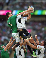 Devin Toner of Ireland and Daniel Carpo of Romania compete for the ball at a lineout. Rugby World Cup Pool D match between Ireland and Romania on September 27, 2015 at Wembley Stadium in London, England. Photo by: Patrick Khachfe / Onside Images