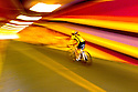 WA09989-00...WASHINGTON - Cyclest in brightly painted tunnel on the Burke-Gilman Trail in Kenmore.  (MR# S1)