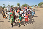 Children displaced by war in the neighboring  Darfur region of Sudan on their way to school in the Goz Amer refugee camp in eastern Chad. A quarter million Darfur refugees live in camps in Chad. Another 2.3 million are internally displaced within Sudan.