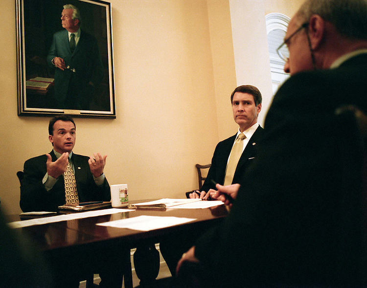 7/30/03.FRIST--Senate Majority Leader Bill Frist, R-Tenn., middle, during a mid-morning meeting with aide Marty Gold, right, an expert on parliamentary procedure, and Dave Schiappa, secretary for the majority..CONGRESSIONAL QUARTERLY PHOTO BY SCOTT J. FERRELL