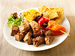 BBQ beef kebabs and sweet corn, peppers &amp; red onions. Funky Stock Photos images.