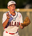 Salado's Cody Wolf bobbles a ball as he prepares to throw to first during game action of a 2A regional quarterfinal against Clifton at the University of Mary Hardin-Baylor baseball field in Belton on Thursday, May 15, 2014.