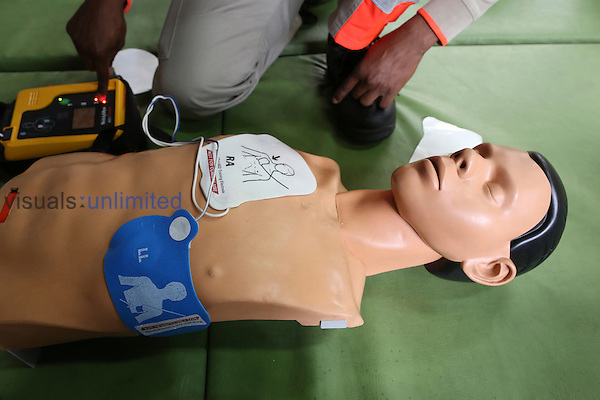 Red Cross volunteer and human models used in training classes for defibrillator use
