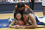 21 December 2007: Duke's Abby Waner (l) and Joy Cheek (r) and Bucknell's Kesha Champion (above) share a laugh after challenging for a loose ball. The Duke University Blue Devils defeated the Bucknell University Bisons 92-49 at Cameron Indoor Stadium in Durham, North Carolina in an NCAA Division I Women's College Basketball game.