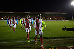 Kidderminster Harriers 3 Gainsborough Trinity 0, 19/11/2016. Aggborough, National League North. Home players making their way from the pitch at Aggborough, home of Kidderminster Harriers (in red) after they played visitors Gainsborough Trinity in a National League North fixture. Harriers were formed in 1886 and have played at their current home since 1890. They won this match  by 3-0 watched by a crowd of 1465. Photo by Colin McPherson.