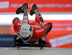 14 December 2007: Daniel Maechler, racing for Switzerland, starts his first run at the FIBT World Cup Skeleton Competition at the Olympic Sports Complex on Mount Van Hovenberg, at Lake Placid, New York, USA. ..Mandatory Photo Credit: Ed Wolfstein Photo