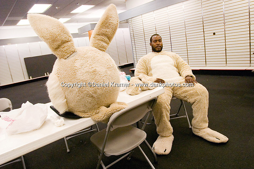 Brittin McClain takes a break between stints at the Easter Bunny at the Northwest Mall in Houston.