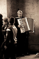 Busker playing accordion in the centre of Turin, Italy