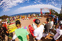 "Pe'ahi, Maui, HAWAII - (December 8, 2012) - Invitees and alternates of the RED BULL JAWS, Paddle at Pe'ahi big wave event gathered high upon the Pe'ahi Overlook in a private blessing that officially opened the three-month holding period for this one-day event. A spiritual ceremony, deeply rooted in Maui's history and Polynesian culture, took place under unusually clear and hot skies, with barely a breath of wind.  . The RED BULL JAWS, Paddle at Pe'ahi presented by Casio G'z One is a one-day big wave paddle-in surfing event that will be held on a single day between December 7, 2012 and March 15, 2013, when wave face heights reach between 30 and 50 feet, and with no assistance from motorized personal watercraft..Led by Kupuna Leslie Kuloloio and Kumu Pulama Collier, surfers listened to the ancestral story of Pe'ahi - known to Hawaiians as Ke Kai 'o Waitakulu, or ""the teary eye place"". Each was presented with a special kihei, or cloak, in recognition of their expertise in big wave riding..  Photo: joliphotos.com"