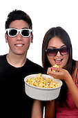 Stock photos of a young couple eating popcorn