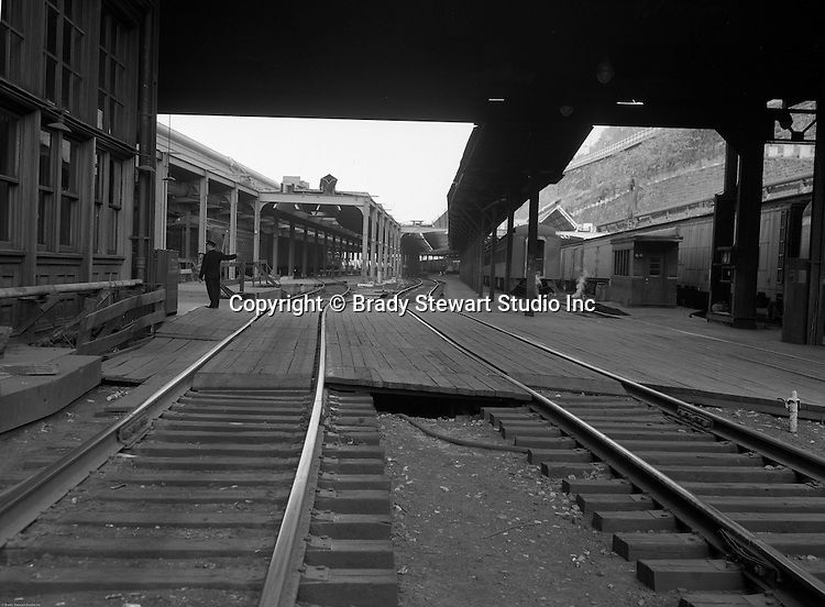 Pittsburgh PA - View of the Pittsburgh's Penn Station platform with yardman directing passengers -1959.