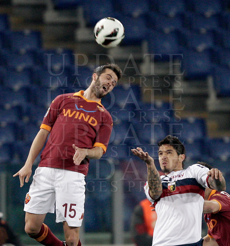 Calcio, Serie A: Roma vs Genoa. Roma, stadio Olimpico, 3 marzo 2013..AS Roma midfielder Miralem Pjanic, of Bosnia, left, jumps for the ball past Genoa forward Juan Manuel Vargas, of Peru',  during the Italian Serie A football match between AS Roma and Genoa at Rome's Olympic stadium, 3 March 2013..UPDATE IMAGES PRESS/Riccardo De Luca