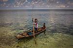 Bajau children on their typical canoe
