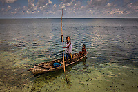 Bajau children on their typical canoe
