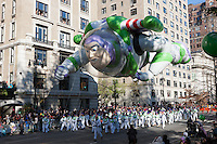 NEW YORK - NOVEMBER 24:  The Buzz Lightyear helium filled balloon floats overhead during the annual Macy's Thanksgiving Day Parade on Thursday, November 24, 2011.