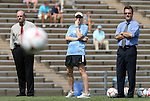30 August 2009: UNC head coach Anson Dorrance (right) with volunteer assistant coach Cindy Parlow (center) and assistant coach Bill Palladino (left). The University of North Carolina Tar Heels defeated the University of North Carolina Greensboro Spartans 1-0 at Fetzer Field in Chapel Hill, North Carolina in an NCAA Division I Women's college soccer game.