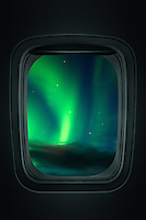 The Northern Lights seen through an airplane window.