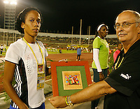 Culia Torrez of Cuba accepting her award after finishing 2nd. in the 800m in a time of 2:01.19sec. at the Jamaica International Invitational Meet held on May 2nd. 2009. Photo by Errol Anderson,The Sporting Image.net
