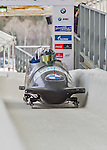 9 January 2016: United States of America pilot Codie Bascue leads his 4-man team as they cross the finish line after their second run of the day at the BMW IBSF World Cup Bobsled Championships at the Olympic Sports Track in Lake Placid, New York, USA. Bascue's team came in 15th for the day, with a 2-run combined time of 1:51.44. Mandatory Credit: Ed Wolfstein Photo *** RAW (NEF) Image File Available ***