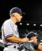 New York Yankees manager Joe Girardi (28) checks his notes in the ninth inning against the Baltimore Orioles at Oriole Park at Camden Yards in Baltimore, Maryland in the second game of a doubleheader on Sunday, August 28, 2011.  The Yankees won the game 8 - 3, earning a split in the two games..Credit: Ron Sachs / CNP.(RESTRICTION: NO New York or New Jersey Newspapers or newspapers within a 75 mile radius of New York City)
