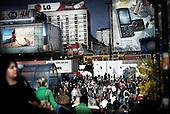 Warsaw 04.04.2008 Poland<br /> Crowd of the people in centre of Warsaw and a lot of bilboards hanged of the building.<br /> (Photo by Adam Lach / Napo Images for Newsweek Polska)<br /> <br /> Tlum ludzi w centrum warszawy i znaczna ilosc reklam wiszacych na budynkach<br /> (Fot Adam Lach / Napo Images dla Newsweek Polska)
