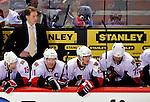 22 March 2010: Ottawa Senators' Head Coach Bruce Boudreau (standing) looks out from behind the bench during a game against the Montreal Canadiens at the Bell Centre in Montreal, Quebec, Canada. The Senators shut out the Canadiens 2-0 in their last meeting of the regular season. Mandatory Credit: Ed Wolfstein Photo