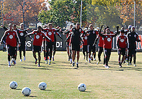 WASHINGTON, DC - NOVEMBER 14, 2012: Players of DC United warm up during a practice session before the second leg of the Eastern Conference Championship at DC United practice field, in Washington, DC on November 14.