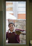 A student cleans a window in the Lydia Paterson Institute in El Paso, Texas. Most of the school's students travel across the border every day from their homes in Juarez, Mexico, to study at the United Methodist-sponsored high school. Many repay part of their scholarships by spending two hours a day cleaning the school.