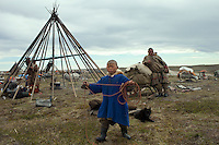 Bovanenkovo ,Yamal Peninsula, Russia, 09/07/2010..A Nenets boy, one of the tribe of indigenous nomadic reindeer herders, prepares to leave their overnight camp on sledges heading north to the Russian Arctic coast.