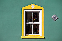Aquamarine colour wall and yellow window border in Kinsale, County Cork, Ireland