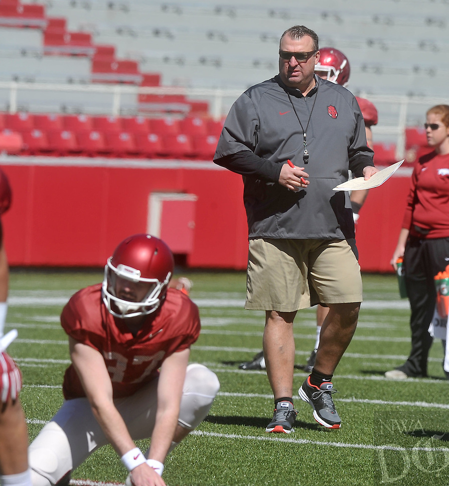NWA Democrat-Gazette/MICHAEL WOODS &bull; @NWAMICHAELW<br /> University of Arkansas coach Bret Bielema watches his team run drills during practice Saturday April 2, 2016, at Razorback Stadium.