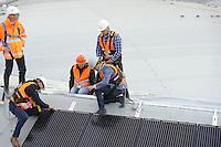 SCHAATSEN: HEERENVEEN: 10-10-2016, IJsstadion Thialf, Gedeputeerde van Fryslân Miechiel Schier en tv presentator Toine van Peperstraten schroefden een zonnepaneel vast tijdens de officiële handeling onder toeziend oog van Thialf bouwdirecteur Willem Jan Elscacker, ©foto Martin de Jong
