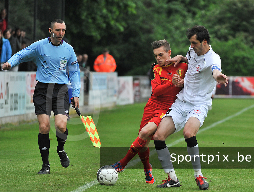 Georgia U19 - Belgium U19 : Leandro Trossard (17) and Nika Sandokhadze (4) in front of assistant referee Hrvoje Turudic (left)<br /> foto DAVID CATRY / Nikonpro.be