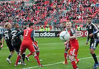24 March 2012: Toronto FC foward/midfielder Ryan Johnson #9, Toronto FC defender Richard Eckersley #27 and San Jose Earthquakes forward Chris Wondolowski #8 all watch as the ball travels wide of the goal during a game between the San Jose Earthquakes and Toronto FC at BMO Field in Toronto..The San Jose Earthquakes won 3-0..