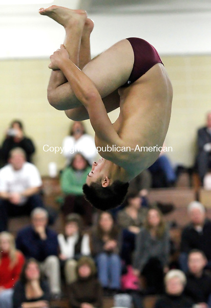 Waterbury, CT-18 January 2012-011812CM07-  Sacred Heart's RJ Domondon completes a dive against Cheshire at Kennedy High School in Waterbury Tuesday night.  Sacred Heart won the meet 94-83.   Christopher Massa Republican-American