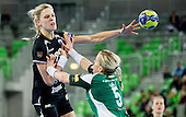 Susann Mueller of Krim vs Heidi Loke of Gyori  during handball match between RK Krim Mercator and Gyori Audi ETO KC (HUN) in 3rd Round of Group B of EHF Women's Champions League 2012/13 on October 28, 2012 in Arena Stozice, Ljubljana, Slovenia. (Photo By Vid Ponikvar / Sportida)