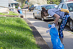 Ashley Mclean picks up trash during Athens Beautification Day on April 9, 2017.