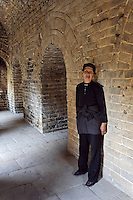 Woman standing in chamber inside a Great Wall watch tower, Simatai Great Wall, China, Asia
