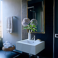 Slate tiles cover the walls and floor of this contemporary bathroom