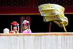 Asia, China, Beijing. Tourists dress in traditional costumes and stand over crowds at the Forbidden Palace.