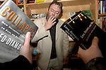 Christopher Hitchens died Thursday at the age of 62. He was a great human.<br /> <br /> CHICAGO, IL-FEB 24, 2005: Author Christopher Hitchens holds court and reads from his books at a Left of Center Bookstore on Chicago's north side.