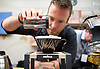 The London Coffee Festival <br /> Truman Brewery, Brick Lane, London, Great Britain <br /> 7th April 2017 <br /> <br /> David Cutler - head of training at Lavazza Coffee UK demonstrates the preparation of coffee for delegates at the London Coffee Festival <br /> <br /> Photograph by Elliott Franks <br /> Image licensed to Elliott Franks Photography Services