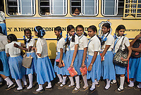 January 26th 2008 _Trivandrum, India _A group of school girls line up to enter their school bus after attending India ñRepublic Dayîevents at the Central Stadium in Trivandrum, India.  Trivandrum is located in the southern state of Kerala.  Photograph by Daniel J. Groshong/Tayo Photo Group