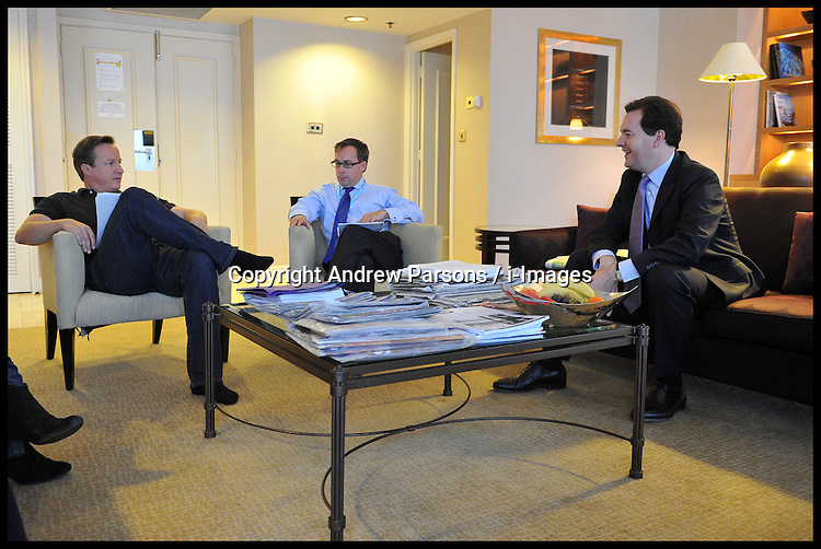 The Prime Minister David Cameron and George Osborne in the Pm's room at The Conservative Party Conference at ICC, Birmingham, On day one of the Party Conference, Sunday October 7, 2012. Photograph by Andrew Parsons / i-Images