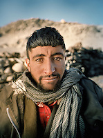 "Assan Khan..Wakhi winter shepherds known as ""Shpunds"" in their settlement of Kher Metek, on the edge of the Little Pamir. They often look over Kyrgyz sheep and yak herds for payment in animals. .Winter expedition through the Wakhan Corridor and into the Afghan Pamir mountains, to document the life of the Afghan Kyrgyz tribe. January/February 2008. Afghanistan"