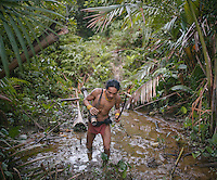 Aman Lepon, a young Mentawai Shaman or usually called Sikerei, living in the village of Buttui. The Mentawai are the tribes living traditionally in the island of Siberut, Indonesia. Here, where the changes came slow, some of the people are still living like their ancestors did centuries ago. They s till practice ancient religion called Arat Sabulungan, which believe that everything in the forest has a spirit.