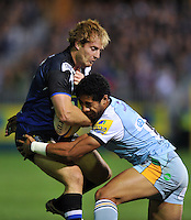 Nick Abendanon is tackled by Ken Pisi. Aviva Premiership match, between Bath Rugby and Northampton Saints on September 14, 2012 at the Recreation Ground in Bath, England. Photo by: Patrick Khachfe / Onside Images
