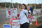 Amendment 26 supporter Joyce Haskins, with her grandchild Landry Bruce, waves to passersby outside the voting booths at the Oxford Conference Center in Oxford, Miss. on Tuesday, November 8, 2011. Mississippians go to the polls today for state and local elections, as well as referendums including the so-called Personhood Amendment.
