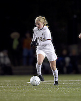 "Boston College midfielder Julia Bouchelle (12) dribbles. Boston College defeated West Virginia, 4-0, in NCAA tournament ""Sweet 16"" match at Newton Soccer Field, Newton, MA."